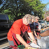 St. Vincent de Paul Parish Men's Club members filling orders at the drive-thru section of their weekly Lenten fish fry. (NTC photo/Donna Ryckaert)