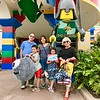 Family photo in front of Legoland entrance.