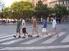 "Doing the ""Abby Road"" thing in Pomplona.<br /> - Linda"