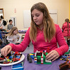 Kids and parents participated in the Lego Inventors hour at the Leominster Public Library on Saturday, Jan. 4, 2020. Lily Millward, 10, of Leominster works on her Lego creation at the event. SENTINEL & ENTERPRISE/JOHN LOVE