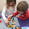 Kids and parents participated in the Lego Inventors hour at the Leominster Public Library on Saturday, Jan. 4, 2020. Siblings Max, 5, and Vivienne Bodurtha, 6, work together on a Lego creation at the event. SENTINEL & ENTERPRISE/JOHN LOVE