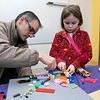Kids and parents participated in the Lego Inventors hour at the Leominster Public Library on Saturday, Jan. 4, 2020. Anneliese tobler, 6, from Leominster works with her dad Michael on a Lego creation. SENTINEL & ENTERPRISE/JOHN LOVE
