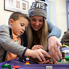 Kids and parents participated in the Lego Inventors hour at the Leominster Public Library on Saturday, Jan. 4, 2020. Daniel Millward, 5, of Leominster works on her Lego creation at the event with his mom Kate. SENTINEL & ENTERPRISE/JOHN LOVE