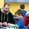 Kids and parents participated in the Lego Inventors hour at the Leominster Public Library on Saturday, Jan. 4, 2020. Jason Brennan, 7, of Leominster works with his step dad Devin Basque during the event.  SENTINEL & ENTERPRISE/JOHN LOVE