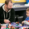 Kids and parents participated in the Lego Inventors hour at the Leominster Public Library on Saturday, Jan. 4, 2020. Jason Brennan, 7, of Leominster works with his step dad Devin Basque during the event.  Watching his Brennan's mom Mary. SENTINEL & ENTERPRISE/JOHN LOVE
