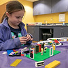 Kids and parents participated in the Lego Inventors hour at the Leominster Public Library on Saturday, Jan. 4, 2020. Audrey Millward, 7, of Leominster works on her Lego creation at the event. SENTINEL & ENTERPRISE/JOHN LOVE