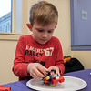 Kids and parents participated in the Lego Inventors hour at the Leominster Public Library on Saturday, Jan. 4, 2020. Max Bodurtha, 5, works on his boat with wheels at the event. SENTINEL & ENTERPRISE/JOHN LOVE