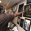 Vanessa Akosah, 18, looks at some of the artwork on display at The First Annual Senior Art Awards Show on Thursday night at Leominster High School. SENTINEL & ENTERPRISE/JOHN LOVE