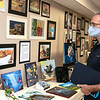Paul Kowalski looks over some of the artwork on display at The First Annual Senior Art Awards Show on Thursday night at Leominster High School. SENTINEL & ENTERPRISE/JOHN LOVE