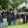 The 15th MA volunteer Infantry along with the Leominster Veteran's Riffle Team salute the fallen during the Leomisnter Memorial Day Ceremony on May 31, 2021 at Carter Park. SENTINEL & ENTERPRISE/JOHN LOVE