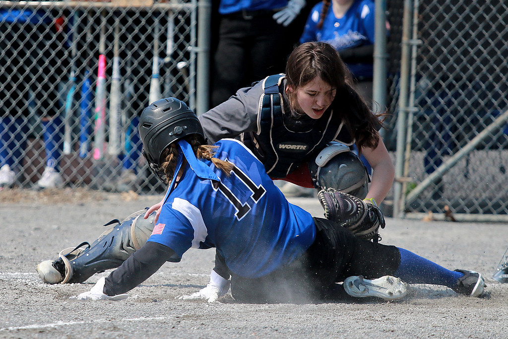 . Leominster High School softball hosted Fitchburg High School on Tuesday after new at Lassie League Complex in Leominster, April 16, 2019. FHS\'s catcher Margo King tries to tag LHS\'s Caiya White as she slides into homeplate during action in the game. Leominster\'s Liz Leger threw a no-hitter as the Blue Devils won, 13-0, in five innings. SENTINEL & ENTERPRISE/JOHN LOVE