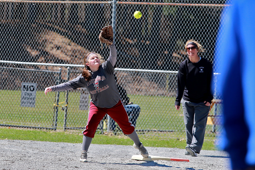 . Leominster High School softball hosted Fitchburg High School on Tuesday after new at Lassie League Complex in Leominster, April 16, 2019. FHS\'s first baseman Lucia Arciprete reaches for a throw during action in the game. SENTINEL & ENTERPRISE/JOHN LOVE