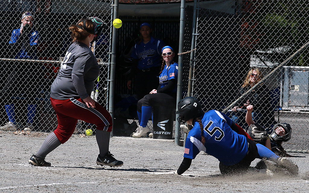 . Leominster High School softball hosted Fitchburg High School on Tuesday after new at Lassie League Complex in Leominster, April 16, 2019. LHS\'s Tamara Landry slides safe into home as FHS\'s pitcher Emily Bourgeois gets the throw from cather Margo King as she lay on the ground. SENTINEL & ENTERPRISE/JOHN LOVE