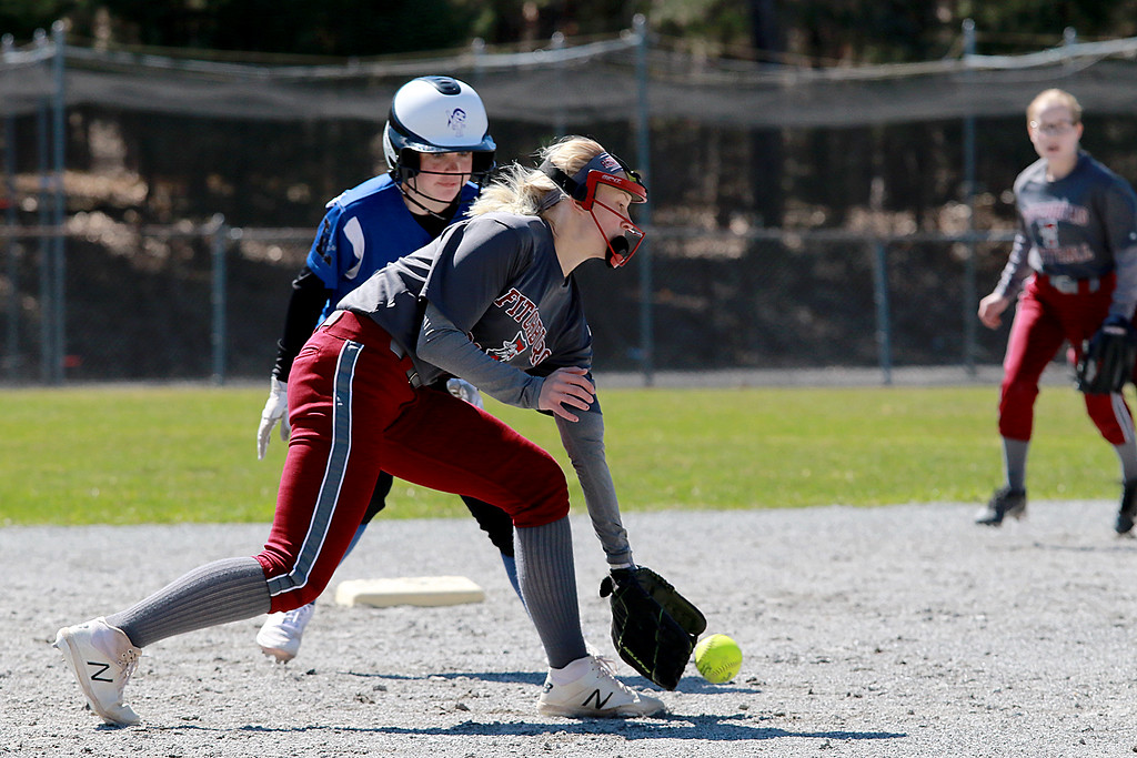 . Leominster High School softball hosted Fitchburg High School on Tuesday after new at Lassie League Complex in Leominster, April 16, 2019. FHS\'s Emma Auger gets in front of a ground ball. SENTINEL & ENTERPRISE/JOHN LOVE