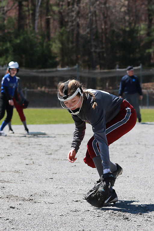 . Leominster High School softball hosted Fitchburg High School on Tuesday after new at Lassie League Complex in Leominster, April 16, 2019. FHS\'s third baseman Lainey Jaramillo strops a ground ball during action in the game. SENTINEL & ENTERPRISE/JOHN LOVE