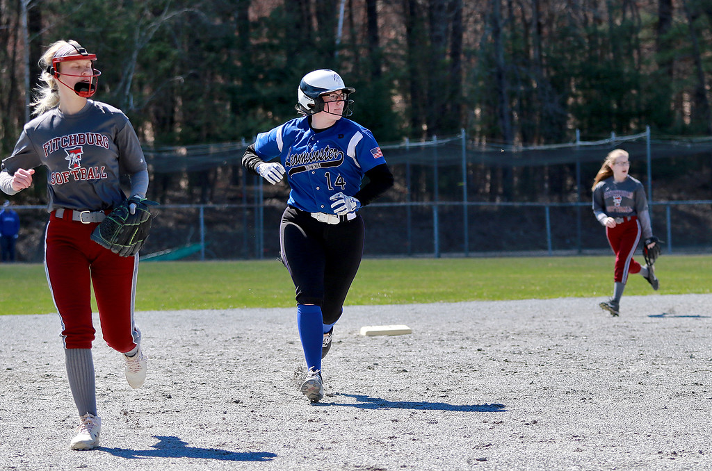 . Leominster High School softball hosted Fitchburg High School on Tuesday after new at Lassie League Complex in Leominster, April 16, 2019. LHS\'s Lauren Dube takes off to third as she watches the play during action in the game. SENTINEL & ENTERPRISE/JOHN LOVE
