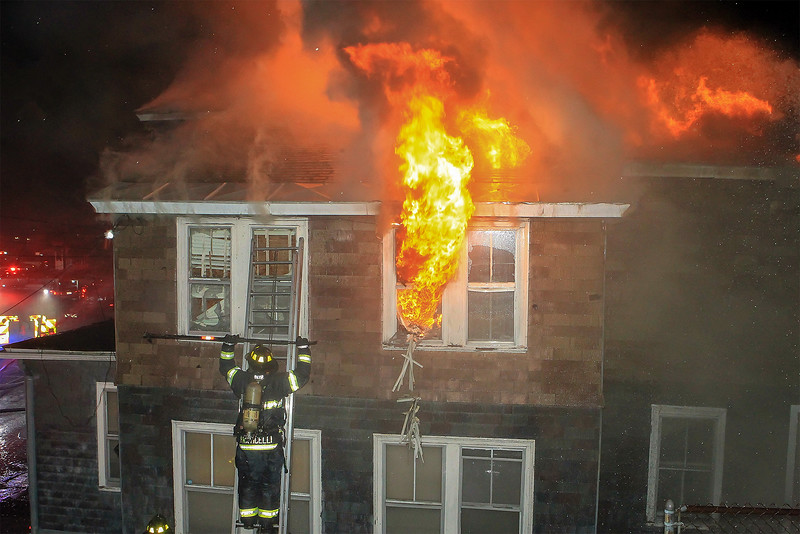 Leominster firefighters work to contain a two-alarm fire that sweep through a Lincoln Terrace multi-family dwelling early Tuesday morning. SENTINEL & ENTERPRISE/SCOTT LAPRADE