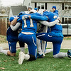 Leominster players take a quiet moment before the start of the second half during Thursday morning's 49-12 Turkey Day victory over Fitchburg. SENTINEL & ENTERPRISE / Ashley Green