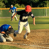 Scott LaPrade photo - 3rd baseman Adam Sears gets hit in the face by a ball as Holden player run and scores