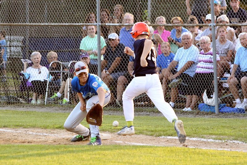 Scott LaPrade photo - 1st basementThomas Rupp attempts the out but Holdens Eli Robbins beats out the throw
