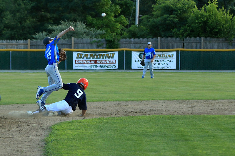 Scott LaPrade photo - 2nd baseman Connor Beaulac gets Holdens Tucker McDonald out and attempts the throw to 1st base
