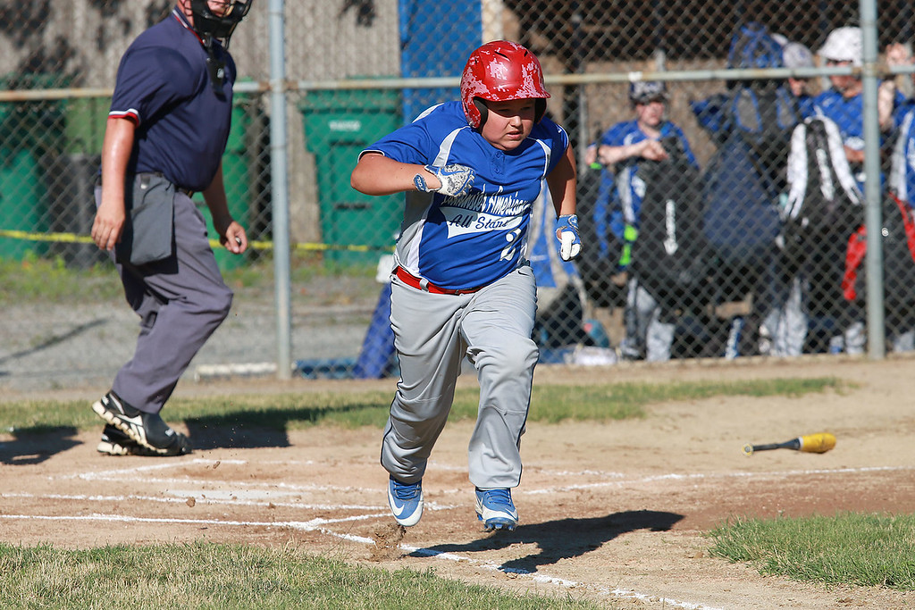 . Leominster American, bark blue shirts, played Leominster National on Friday night at Angelo Picucci Field in Leominster. Leominster American Marcus Beaudoin takes off down the first baseline after his hit during action in the game.  SENTINEL & ENTERPRISE/JOHN LOVE