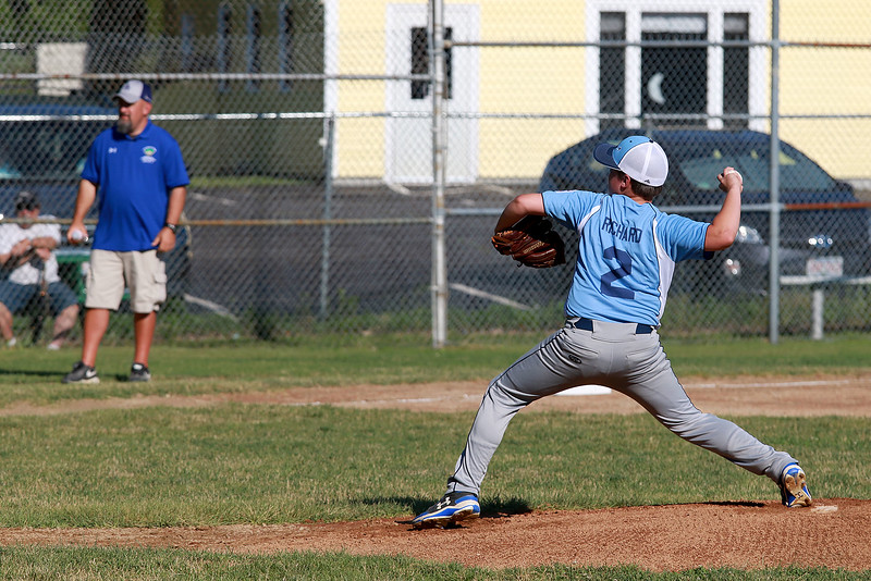 Leominster American, bark blue shirts, played Leominster National on Friday night at Angelo Picucci Field in Leominster. Leominster American pitcher Reid Richard winds up to deliver a pitch during action in the game. SENTINEL & ENTERPRISE/JOHN LOVE