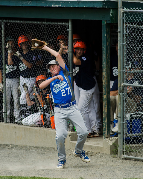 Leominster American's Michael Anderson catches a foul ball during the game against Holden on Saturday, July 22, 2017. SENTINEL & ENTERPRISE / Ashley Green