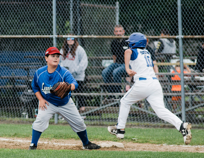 Leominster American's John Escabi tags Lunenburg's Miles Seminatore out at first during the game on Tuesday, July 25, 2017. SENTINEL & ENTERPRISE / Ashley Green