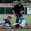 Lunenburg's Eli Wright slides safely under the tag of Leominster American's Brandon Ciccolini on Tuesday, July 25, 2017. SENTINEL & ENTERPRISE / Ashley Green