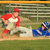 Photo Scott LaPrade - Will Hoyle hits a triple scores a run but is called out at 3rd base with Athol's Jeremy Vezina making the tag