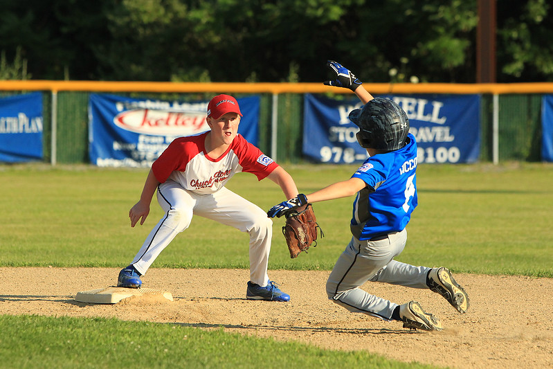 Photo Scott LaPrade - Brandon Ciccolini attempts the slide at 2nd but is called out with Athols Caleb LaPointe getting the out