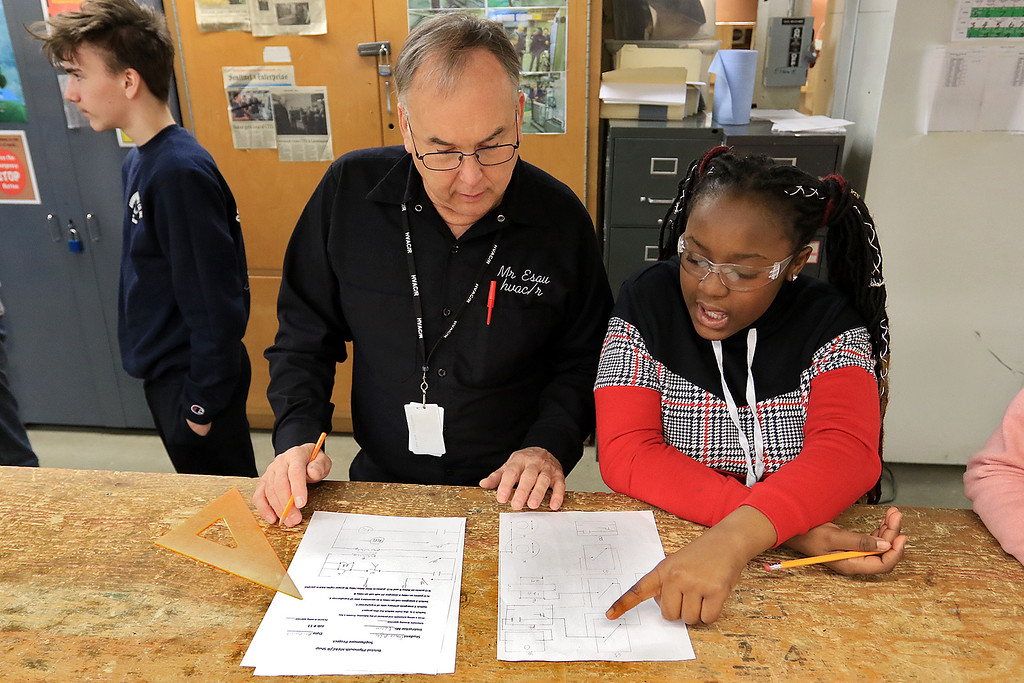 . Heating, ventilation, and air conditioning (HVAC)companies were at Leominster Center For Technical Education Innovation (CTEi ) on Thursday morning to talk to the students in the school HVAC program about opportunities in the field and with their companies. HVAC/R instructor Russ Esau helps sophomore Eunice Adjei during class. She had drawn a schematic to show a fix to an electrical problem.  SENTINEL & ENTERPRISE/JOHN LOVE