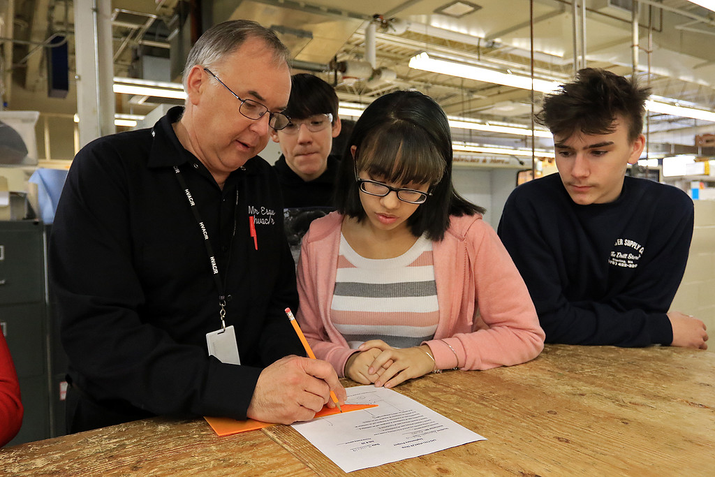 . Heating, ventilation, and air conditioning (HVAC)companies were at Leominster Center For Technical Education Innovation (CTEi ) on Thursday morning to talk to the students in the school HVAC program about opportunities in the field and with their companies. HVAC/R instructor Russ Esau helps sophomore Aaliyah Padilla during class. She had drawn a schematic to show a fix to an electrical problem. Listening in are Padilla\'s fellow classmates sophomores Tim Levesque and Alex Erickson. SENTINEL & ENTERPRISE/JOHN LOVE