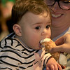 Eva Pepol, 9 months, tries a cannoli at Leominster's Cannoli Festival on Thursday night, October 4, 2018. SENTINEL & ENTERPRISE/JOHN LOVE