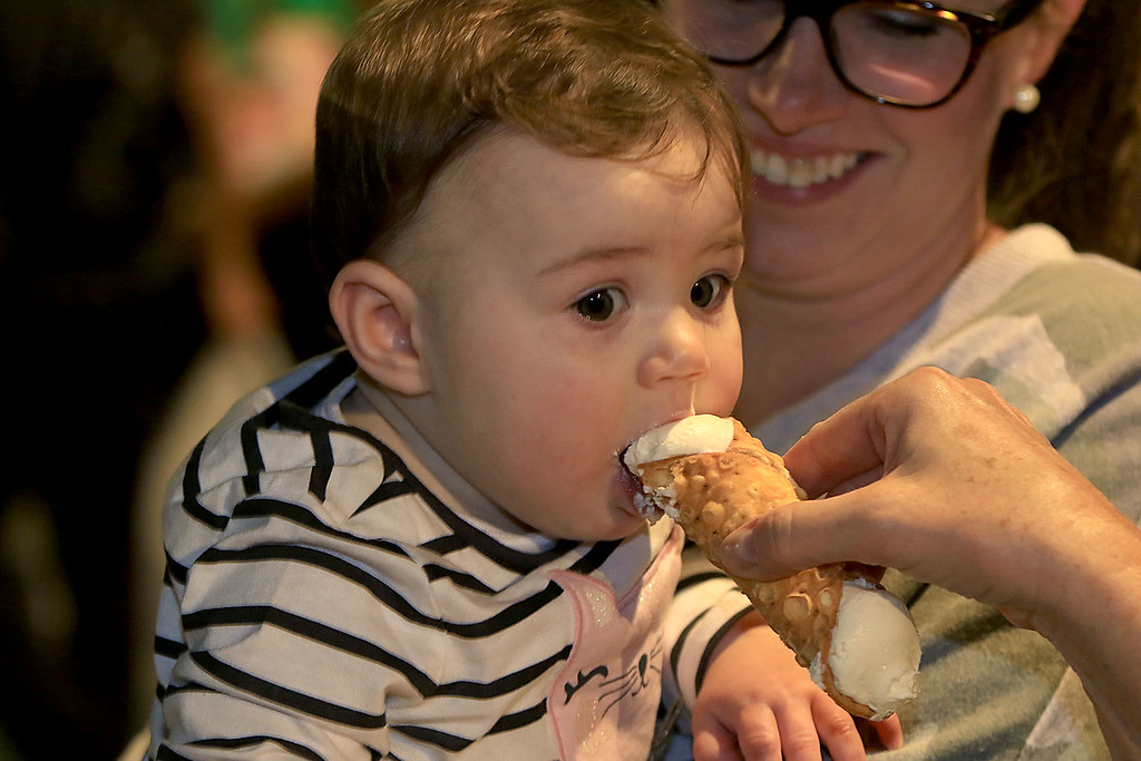 . Eva Pepol, 9 months, tries a cannoli at Leominster\'s Cannoli Festival on Thursday night, October 4, 2018. SENTINEL & ENTERPRISE/JOHN LOVE