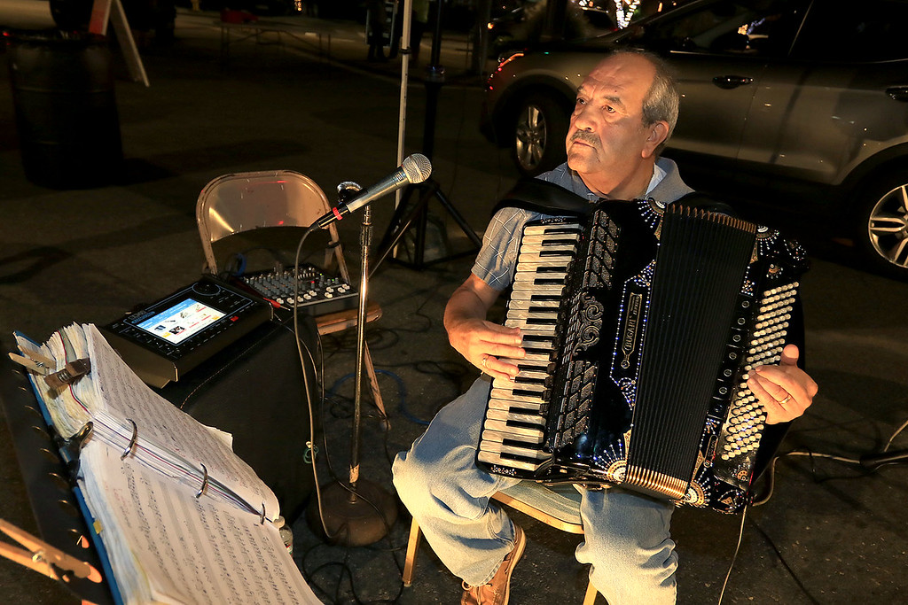 . Italo DeMasi entertains the crowds at Leominster\'s Cannoli Festival on Thursday night, October 4, 2018 with his accordion. SENTINEL & ENTERPRISE/JOHN LOVE