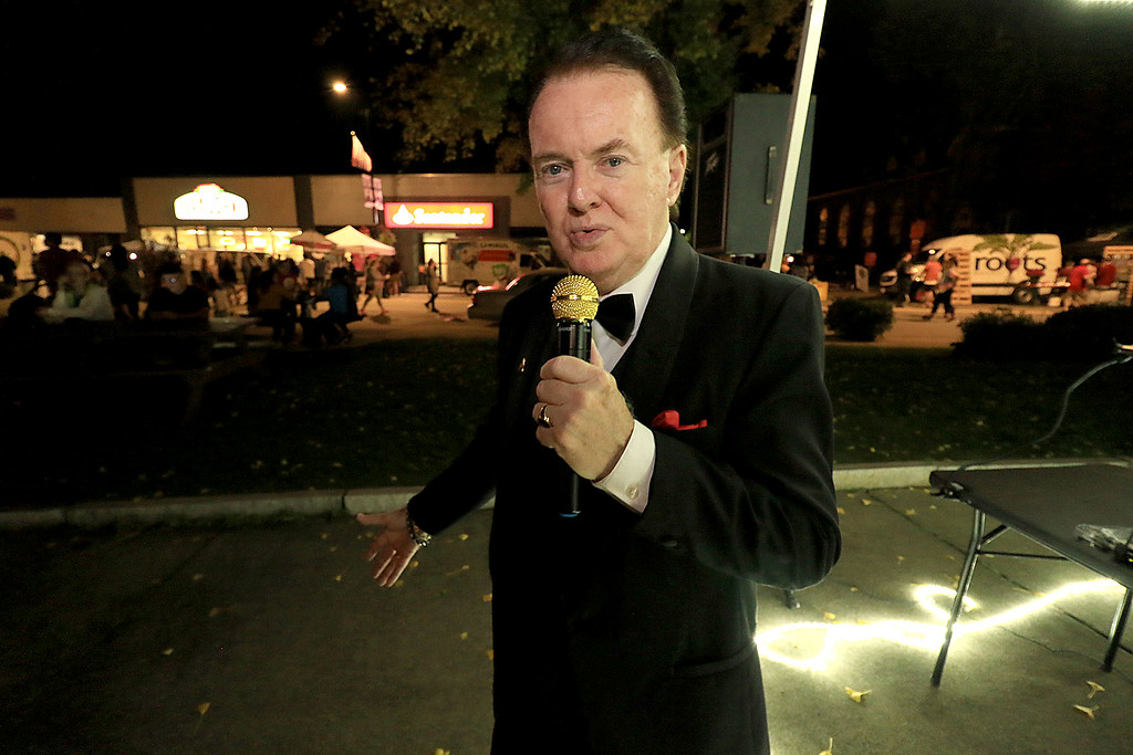 . George Lyons entertains the crowds at Leominster\'s Cannoli Festival on Thursday night, October 4, 2018. SENTINEL & ENTERPRISE/JOHN LOVE