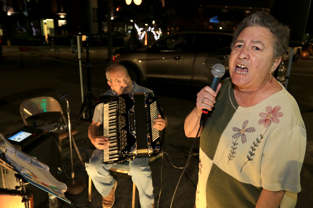 . Leominster resident Rose Tantillo grabbed the microphone and helped Italo DeMasi entertain the crowds at Leominster\'s Cannoli Festival on Thursday night, October 4, 2018. SENTINEL & ENTERPRISE/JOHN LOVE