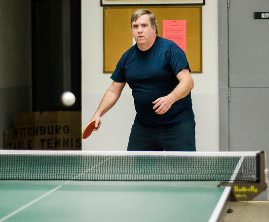 Club founder Chris Kalagher participates in the Fitchburg-Leominster Table Tennis Club at the Leominster Veterans Memorial Center on Thursday evening. SENTINEL & ENTERPRISE / Ashley Green