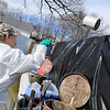 Leominster DPW yard had a hazardous waste collection day on Saturday from 9 a.m. to noon. This happens four times a year and is paid for by G.W. Shaws. Mike with US Ecology throws a paint can into a dumpster aster he emptied it so the contents could be disposed of correctly. SENTINEL & ENTERPRISE/JOHN LOVEa