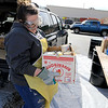 Leominster DPW yard had a hazardous waste collection day on Saturday from 9 a.m. to noon. This happens four times a year and is paid for by G.W. Shaws. Thea Bertram with US Ecology helps empty a residents vehicle of the hazardous waist they brought to the collection day. ENTINEL & ENTERPRISE/JOHN LOVE