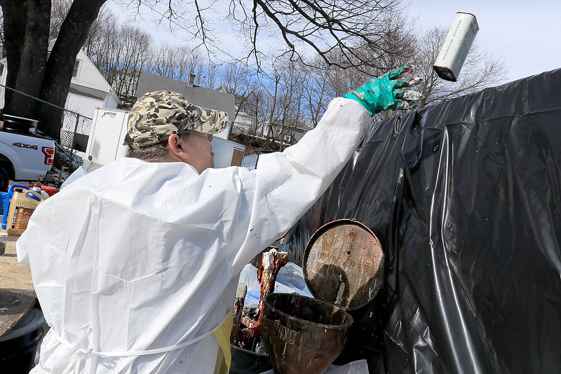 Leominster DPW yard had a hazardous waste collection day on Saturday from 9 a.m. to noon. This happens four times a year and is paid for by G.W. Shaws. Mike with US Ecology throws a can into a dumpster aster he emptied it so the contents could be disposed of correctly. SENTINEL & ENTERPRISE/JOHN LOVE