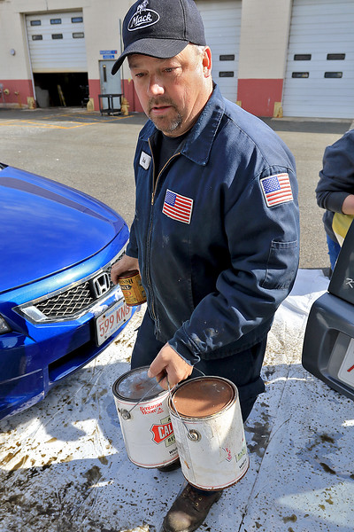 Leominster DPW yard had a hazardous waste collection day on Saturday from 9 a.m. to noon. This happens four times a year and is paid for by G.W. Shaws. Owner of G.W. Shaws Glen Shaw helps empty a residents vehicle of the stuff they dropped off during the collection day. SENTINEL & ENTERPRISE/JOHN LOVE