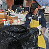 Leominster DPW yard had a hazardous waste collection day on Saturday from 9 a.m. to noon. This happens four times a year and is paid for by G.W. Shaws. Rick Genzel with US ecology helps empty a residents vehicle of some bulbs they dropped off during the collection day. SENTINEL & ENTERPRISE/JOHN LOVE