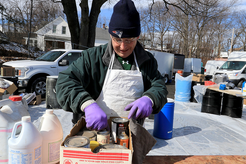 Leominster DPW yard had a hazardous waste collection day on Saturday from 9 a.m. to noon. This happens four times a year and is paid for by G.W. Shaws. Jon Bowden with US Ecology sorts the stuff that was dropped off. SENTINEL & ENTERPRISE/JOHN LOVE
