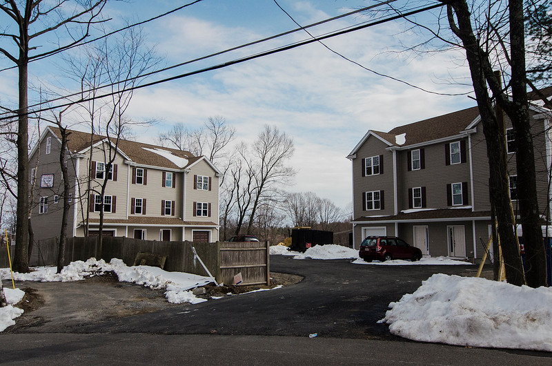 A multi-family development has Leominster residents mulling the possibility of outlawing shared driveways in the city. This project has shared driveways that exit onto both Lowe and Pleasant. Pictured here is the driveway that exits onto Lowe Street. SENTINEL & ENTERPRISE / Ashley Green