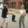 FF Dave Fagone gets a donation from a walker downtown