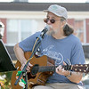 Monument Square Farmers Market in Leominster was held on Saturday, August 31, 2019. John Sullivan entertains the crowd at the market with some music. SENTINEL & ENTERPRISE/JOHN LOVE