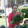 Monument Square Farmers Market in Leominster was held on Saturday, August 31, 2019. Looking to buy some lettuces from Sholan Farms table at the market is June Saenghan with Max Buaphan, 4, both from Lunenburg. SENTINEL & ENTERPRISE/JOHN LOVE